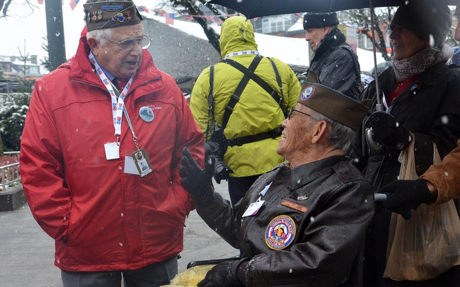 World War II veterans Jack Foy, left, and Bob Izumy talk before a wreath-laying ceremony in Bastogne, Belgium, Dec. 13, 2014, that was part of commemorations marking the 70th anniversary of the Battle of the Bulge.