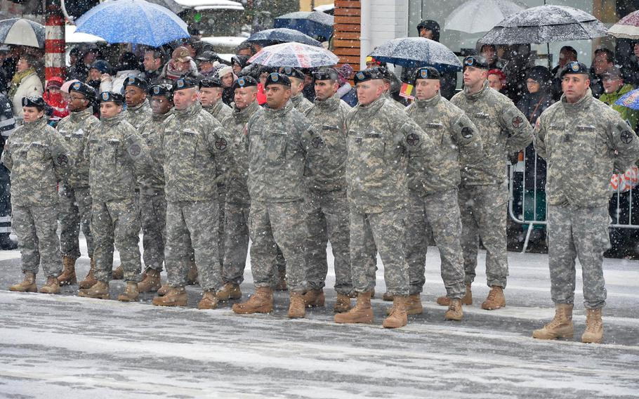 American soldiers stand in formation at a wreath-laying ceremony on McAuliffe square in Bastogne, Belgium, Saturday, Dec. 13, 2014. The ceremony was part of commemorations marking the 70th anniversary of the Battle of the Bulge.