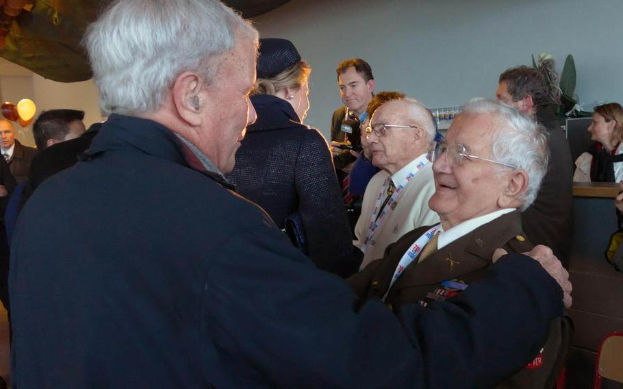 Former TV anchorman and ''The Greatest Generation'' author Tom Brokaw talks with World War II veteran James Morgia at a reception during commemorations of the 70th anniversary of the Battle of the Bulge in Bastogne, Belgium, Saturday, Dec. 13, 2014. Brokaw was part of the U.S. presidential delegation.