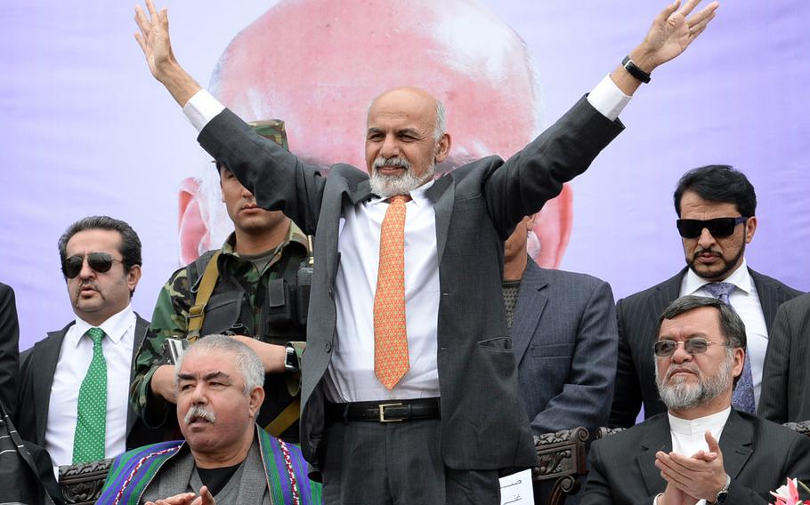 Then-presidential candidate Ashraf Ghani waves to the crowd at a campaign rally in Kabul on April 1, 2014. After a 2nd round of voting and a protracted dispute over allegations of fraud, Ghani assumed Afghanistan's presidency in September 2014.