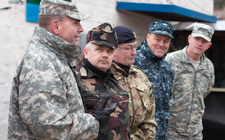 Lt. Gen. Ben Hodges, U.S. Army Europe commander, left, Hungarian Defense Force Joint Force Command commander Maj. Gen. Sandor Fucsku, British Maj. Gen. David Cullen, U.S. Navy Rear Adm. John N. Christenson and the deputy chief of staff of operations for the Allied Rapid Reaction Corps, U.S. Army Brig. Gen. Joseph Harrington, field questions at the training grounds at Hohenfels, Germany, during Allied Spirit I, Jan. 23, 2015.