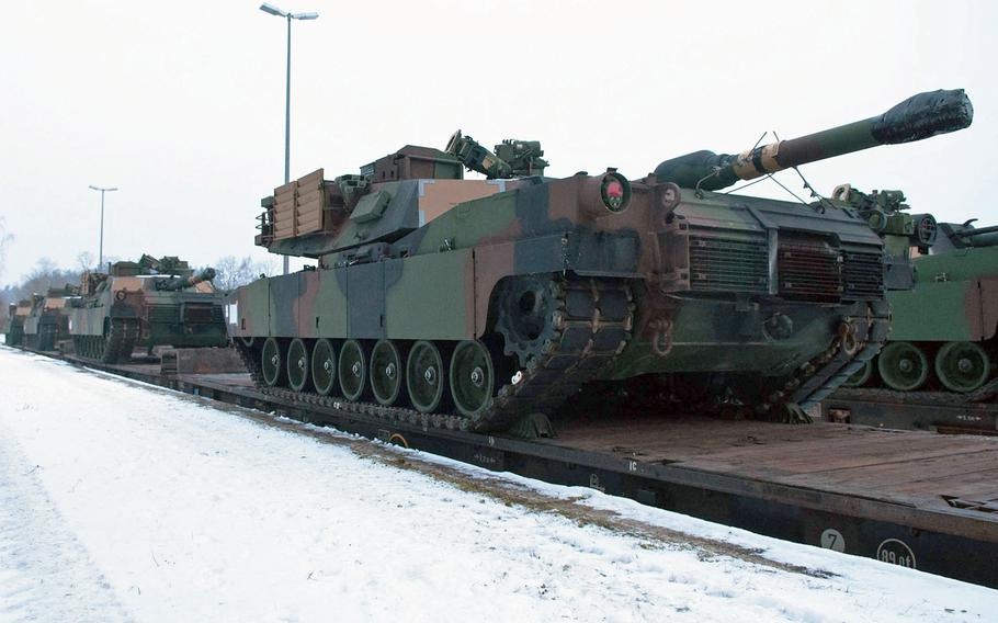 M1A2 Abrams tanks arrive at the Grafenwoehr railhead, Jan. 31, 2014. U.S. Army Europe will soon dispatch a survey team into eastern Europe to scout potential locations for tanks and other military hardware in connection with a broader effort to bolster the U.S. military presence in a region rattled by Russia's intervention in Ukraine, the Army's top commander in Europe Lt. Gen. Ben Hodges, said Friday, Jan. 23, 2015.