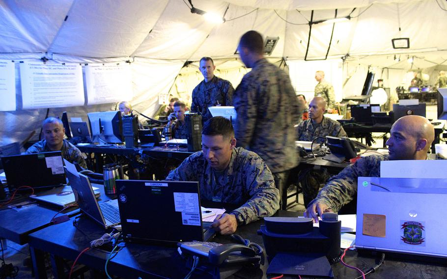 Marines in the combat operations center plan an attack on an enemy force occupying a partner nation during a training exercise at Camp Pendleton, Calif. The exercise, which simulates the deployment of 50,000 troops, is the first of its scale in 12 years.