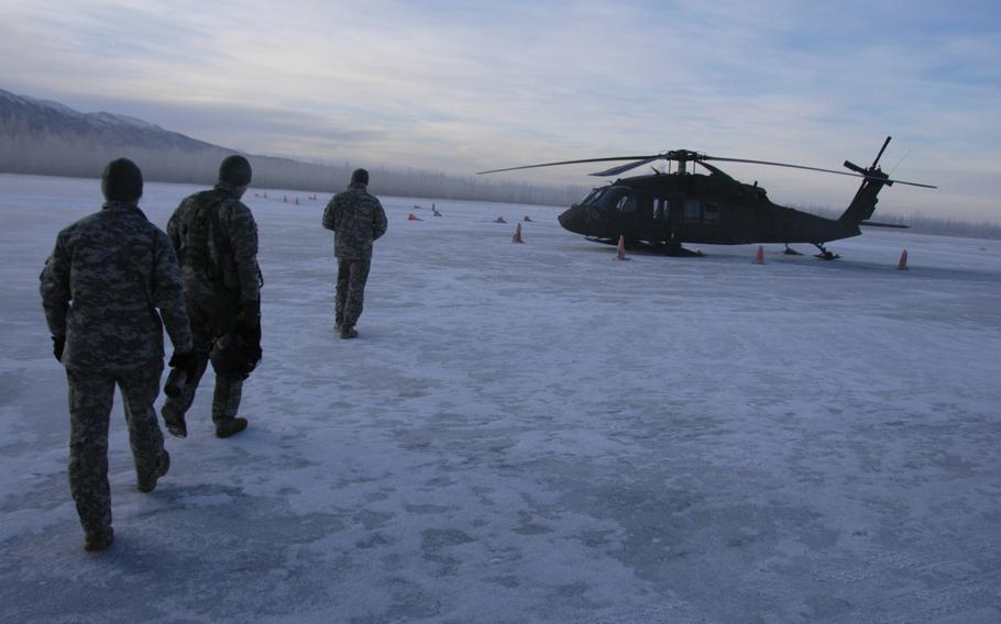 Members of the Alaska Army National Guard prepare for an early morning mission out of Fort Richardson, Alaska on Feb. 13, 2015.
