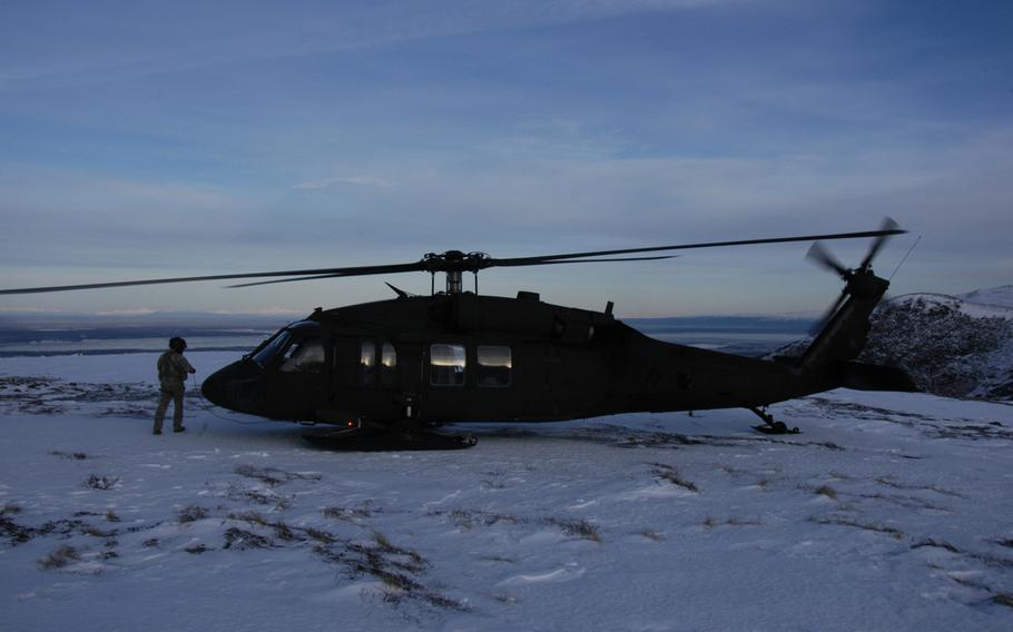 An Alaska Army National Guard UH-60 Black Hawk helicopter prepares to take off from a mountain peak near Anchorage, Alaska, on Feb. 13, 2015. In a matter of minutes, aircraft here can fly beyond the reach of ground-based emergency assistance.