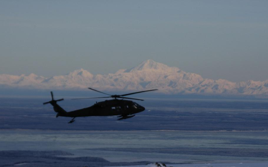 An Alaska Army National Guard UH-60 Black Hawk helicopter flies past Mount McKinley, the highest mountain in North America on Feb.13, 2015. Alaska is the most dangerous state for pilots, statistics show.