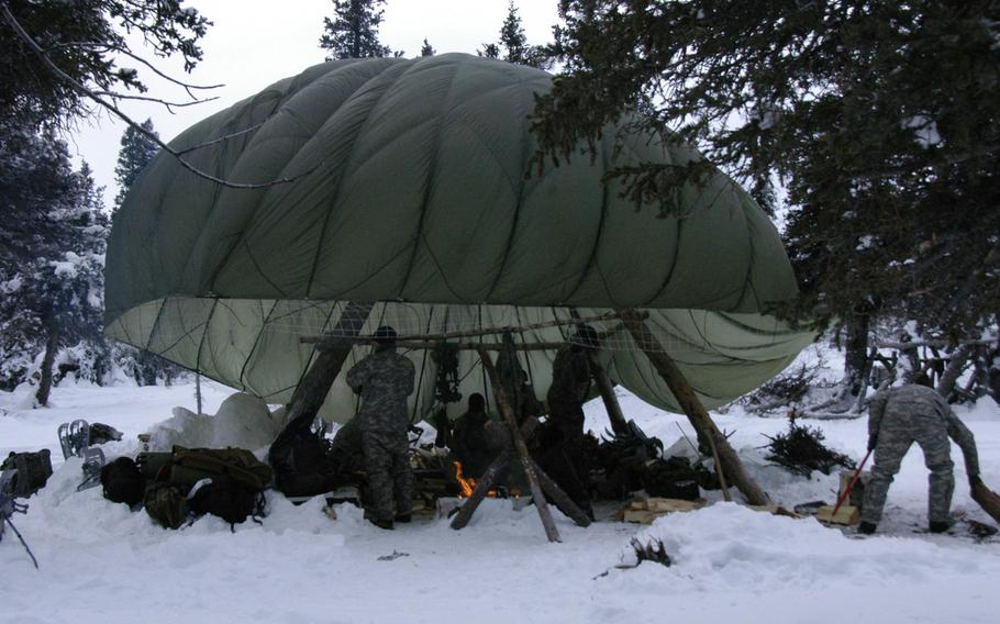 A parachute provides shelter for Army aviators during arctic survival training at the Northern Warfare Training Center in Alaska on Feb.10, 2015.