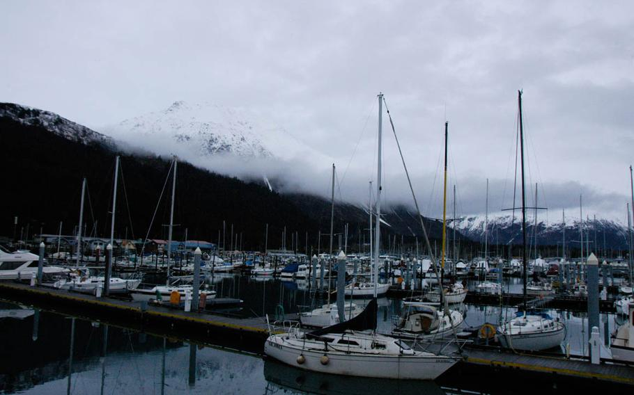 The marina at Seward, Alaska, is backed by stunning mountain scenery. The U.S. military resort in Seward has its own fleet of charter fishing boats — launched from a military dock in the harbor — that take guests out to hook halibut, salmon, rockfish and ling cod