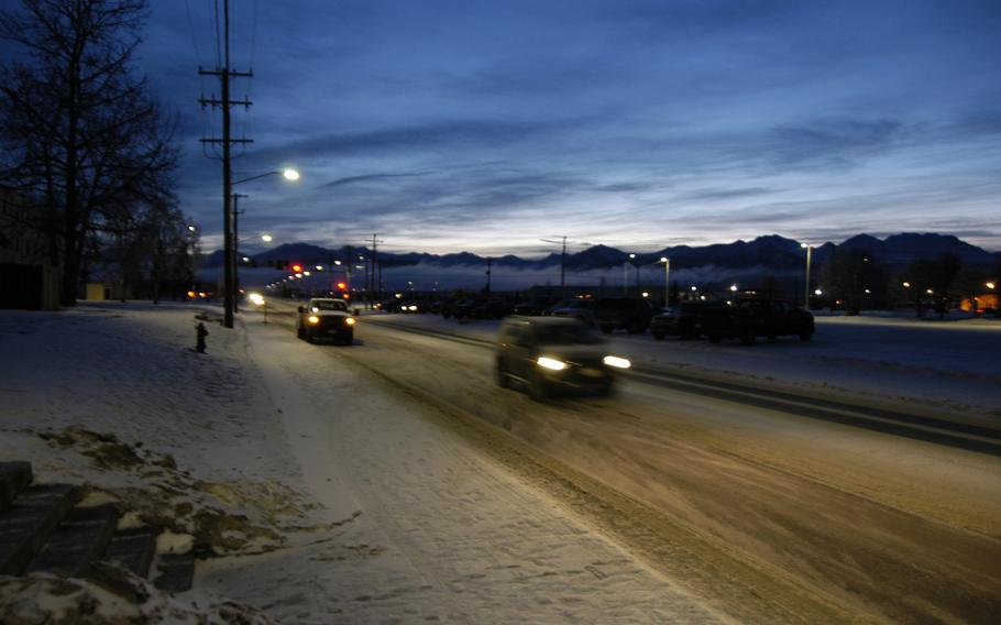 Early morning traffic on Joint Base Elmendorf-Richardson in February 2015.  Many who are stationed there choose to return to the area after leaving the service. The 49th state is home to more than 76,000 veterans.