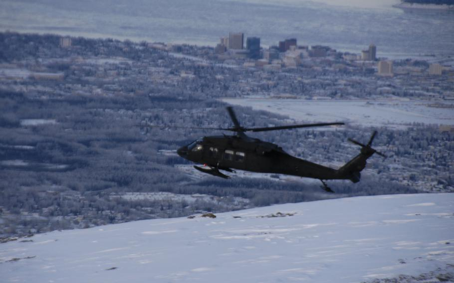 An Alaskan Army National Guard Black Hawk helicopter flies over Anchorage in February 2015.