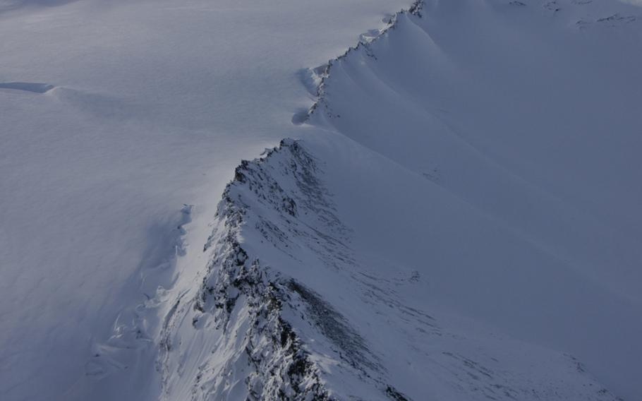 A mountain ridge near Anchorage as seen from an Alaskan Army National Guard Black Hawk helicopter in February 2015. Troops train in cold winter survival tactics because being lost in the Alaskan wilderness could be deadly.