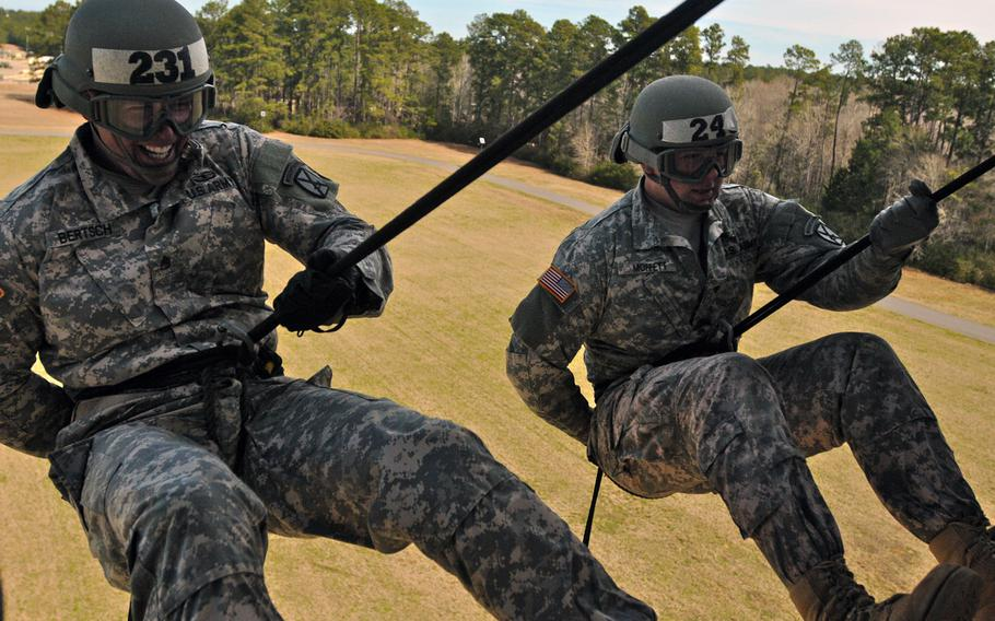 Candidates from across Fort Polk complete their final day of training during 10th Mountain Division?s Light Fighter School, Air Assault course, by rappelling from the bay of a UH-60 Black Hawk on Feb. 19, 2015 at Fort Polk?s Honor Fiel in Louisiana.