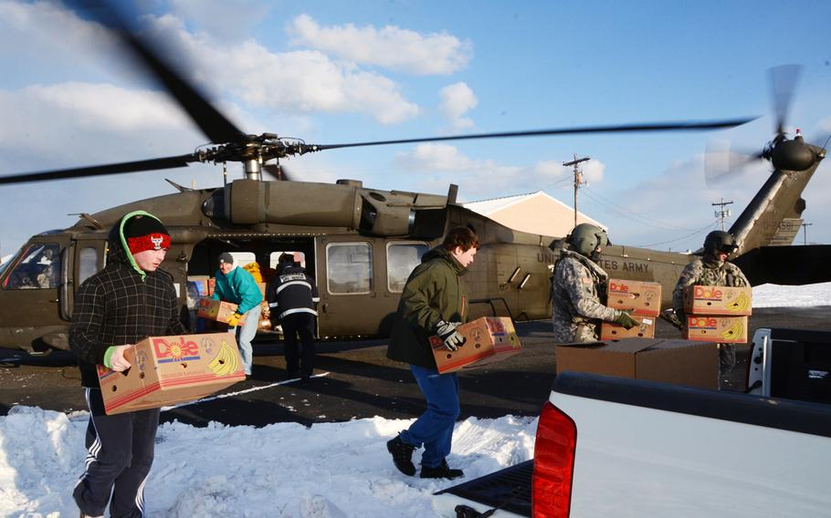 A Virginia Army National Guard aviation crew from the Sandston-based 2nd Battalion, 224th Aviation Regiment delivers food, mail and medicine on Feb. 19, 2015, to iced-in Tangier Island, Va.
