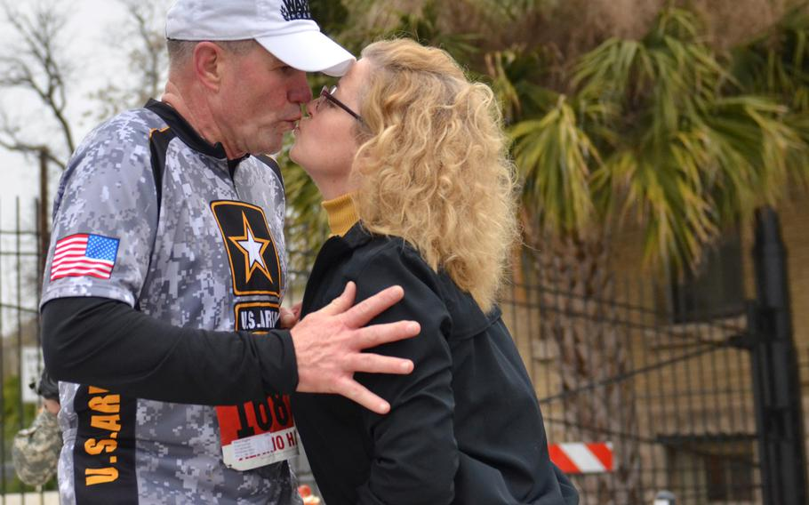 Lt. Gen. Perry L. Wiggins, U.S. Army North (Fifth Army) commanding general, Fort Sam Houston, shares a kiss with his wife, Annette, during the H-E-B Alamo Run Fest half marathon Feb. 22, 2015.