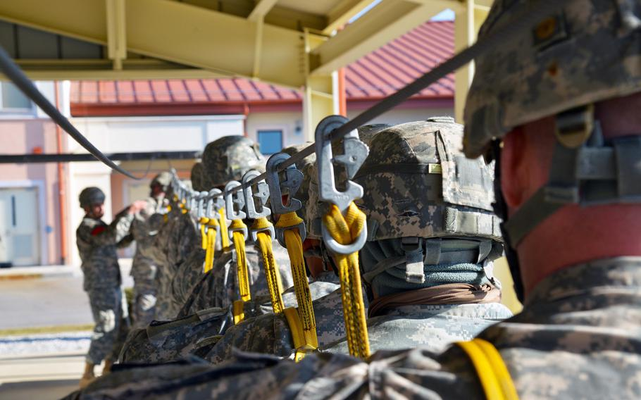 Paratroopers assigned to the 173rd Brigade Support Battalion, 173rd Airborne Brigade, prepare at Aviano Air Base, Italy, for an airborne operation on Juliet Drop Zone in Pordenone, Italy, on Feb. 19, 2015.
