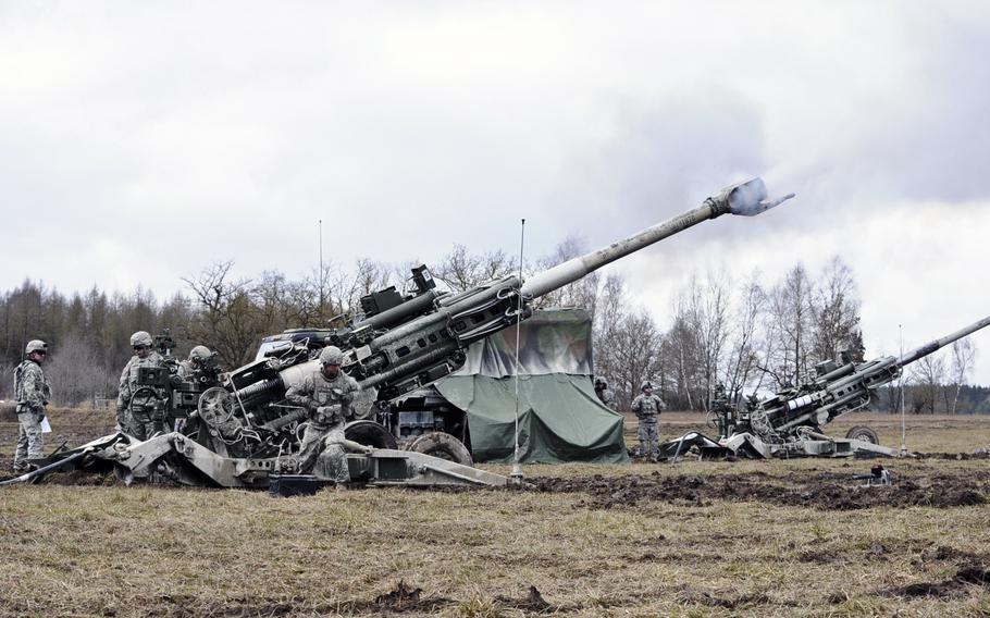 Battery A, Field Artillery Squadron, 2nd Cavalry Regiment soldiers ready their M777 Howitzers during a live-fire exercise at the Grafenwoehr Training Area on Feb. 24, 2015.