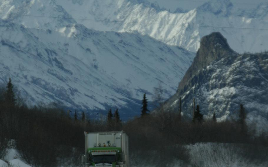 A big rig rolls along the highway between Anchorage and Delta Junction, Alaska, in February 2015.