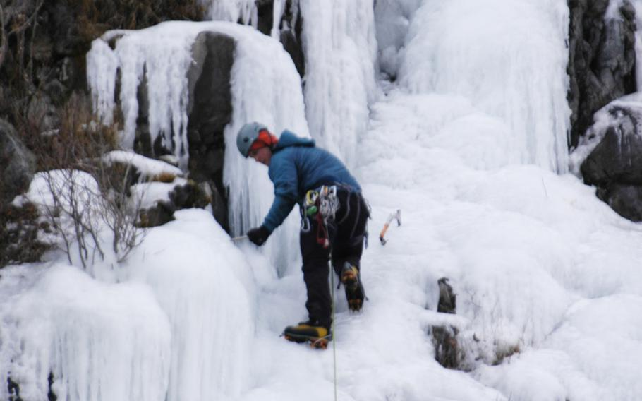 An ice climber near Anchorage, Alaska, in February 2015.  Outdoor activities are big among military members stationed there.
