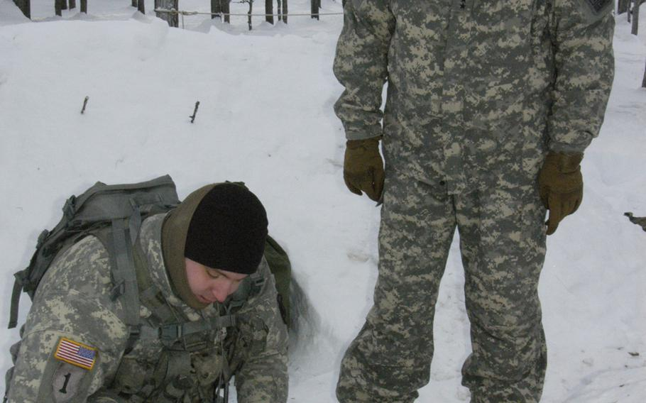 A soldier demonstrates cold-weather survival skills to Gen. Ray Odierno, when the Army chief of staff visited Black Rapids Training Site, Alaska, in February.