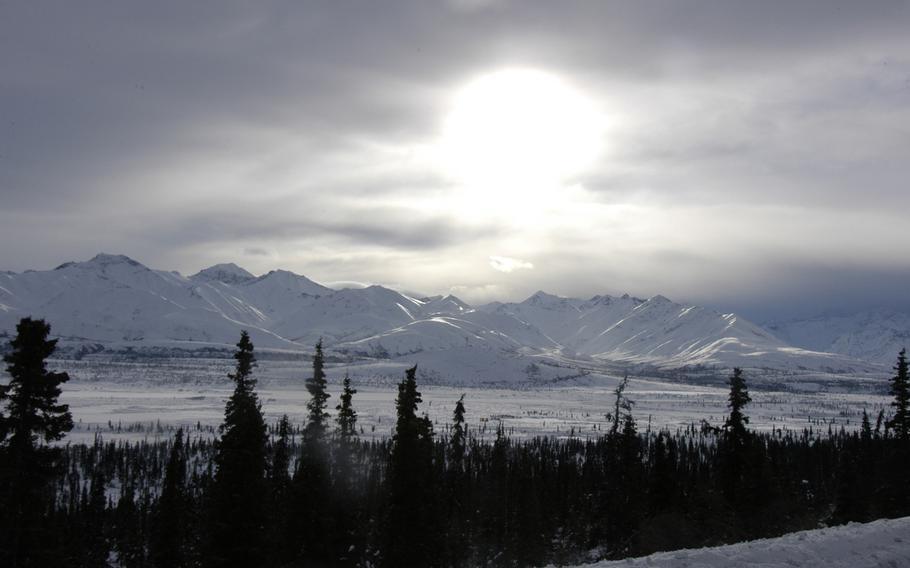 The weak winter sun struggles to warm up a frozen landscape near Black Rapids Training Site, Alaska.