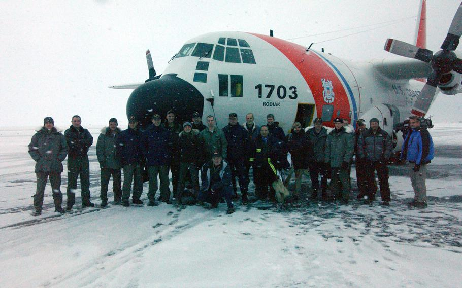 The 22 passengers and crew of Coast Guard HC-130 Hercules airplane 1703 stand for a group photo after successfully reaching the North Pole in 2008. As countries race to gain mineral rights to the Arctic Circle, the U.S. lags behind potential competitor Russia, which is better equipped to traverse the icy region. For instance, the U.S. Navy hasn't has tried to reach the North Pole in the last four years.