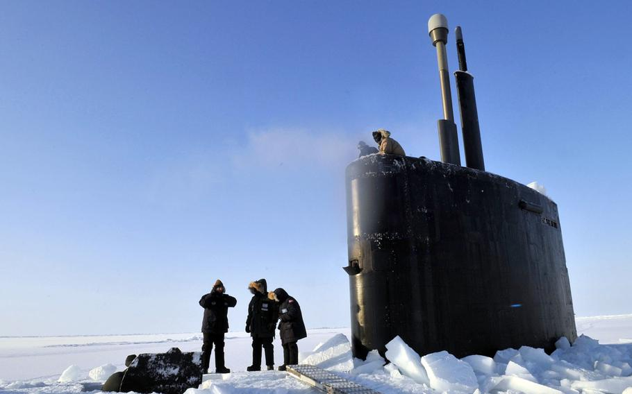 Members of the Applied Physics Laboratory Ice Station clear ice from the hatch of the Los Angeles-class submarine USS Annapolis after the sub broke through the ice while participating in Ice Exercise 2009 in the Arctic Ocean. The Navy hasn't tried to break through the ice at the top of the world since 2011.