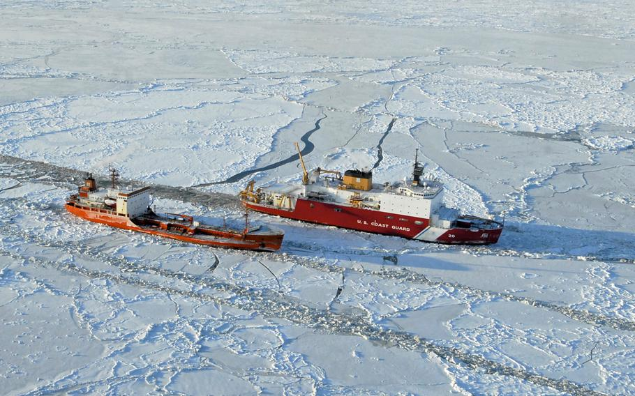 The Coast Guard Cutter Healy breaks ice around the Russian-flagged tanker Renda 250 miles south of Nome, Alaska, on Jan. 6, 2012. The Healy is the U.S. military's only operating polar icebreaker. Russia, on the other hand, has the world's largest fleet of icebreakers, essential to a region rich with natural resources.