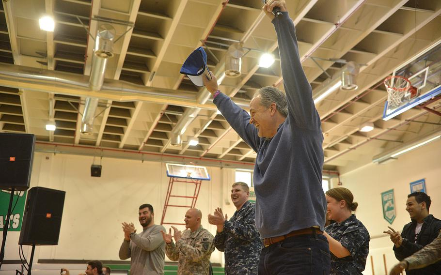 """Indianapolis Colts coach Chuck Pagano cheers during a football-throwing event at the USO Spring Troop visit in Naples, Italy, on Monday, March 3, 2015. Pagano is one 10 celebrities joining Vice Chairman of the Joint Chiefs of Staff Adm. James """"Sandy"""" Winnefeld on the tour, which was to visit overseas military bases over seven days."""