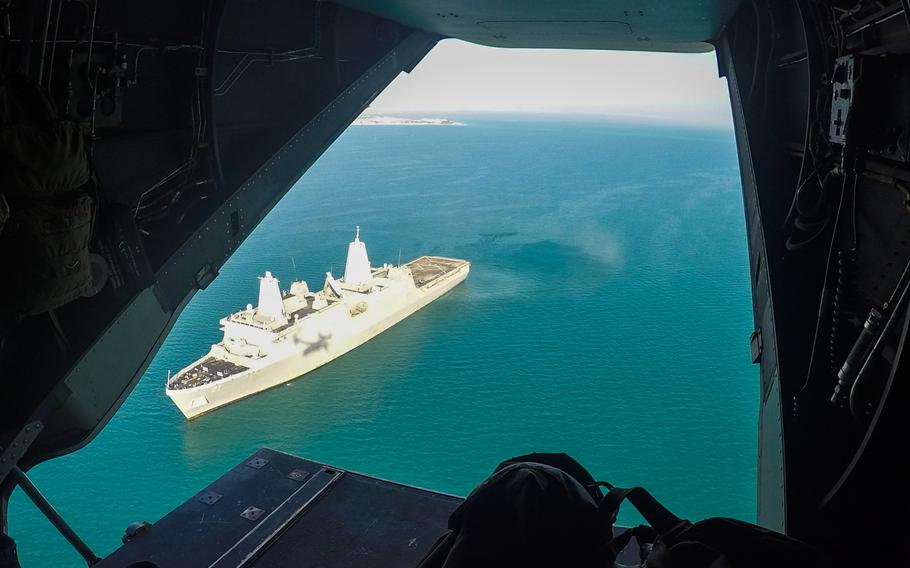 The Mayport, Fla.-based amphibious transport dock ship USS New York positioned off the coast of Kuwait, March 1, 2015. The picture was taken from an MV-22 Osprey shortly after it took off from the ship's flight deck.