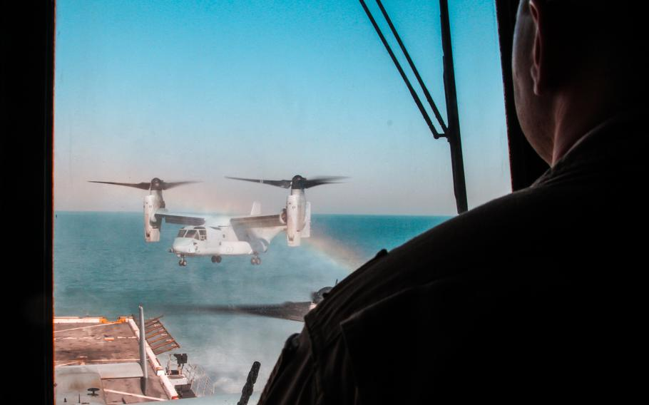 An MV-22 Osprey lands on the flight deck of the amphibious transport dock ship USS New York while it's anchored off the coast of Kuwait, on March 1, 2015.