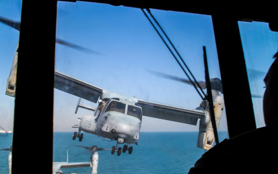 An MV-22 Osprey lands on the flight deck of the amphibious transport dock ship USS New York while it's anchored off the coast of Kuwait, Sunday, March 1, 2015.
