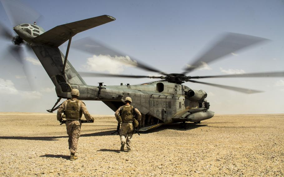 U.S. Marines and sailors assigned to the 26th Marine Expeditionary Unit prepare to depart Al Galail, Qatar, May 3, 2013, via a CH-53E Super Stallion after Exercise Eagle Resolve 13. Eagle Resolve is an annual multilateral exercise designed to enhance regional cooperation by Gulf Cooperation Council nations and U.S. Central Command.