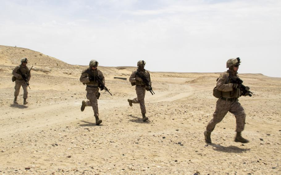 U.S. Marines and sailors assigned to the 26th Marine Expeditionary Unit conduct bilateral training with members of the Qatar Emiri Land Forces in Al Galail, Qatar, April 28, 2013. Eagle Resolve is an annual multilateral exercise designed to enhance regional cooperation by Gulf Cooperation Council nations and U.S. Central Command.