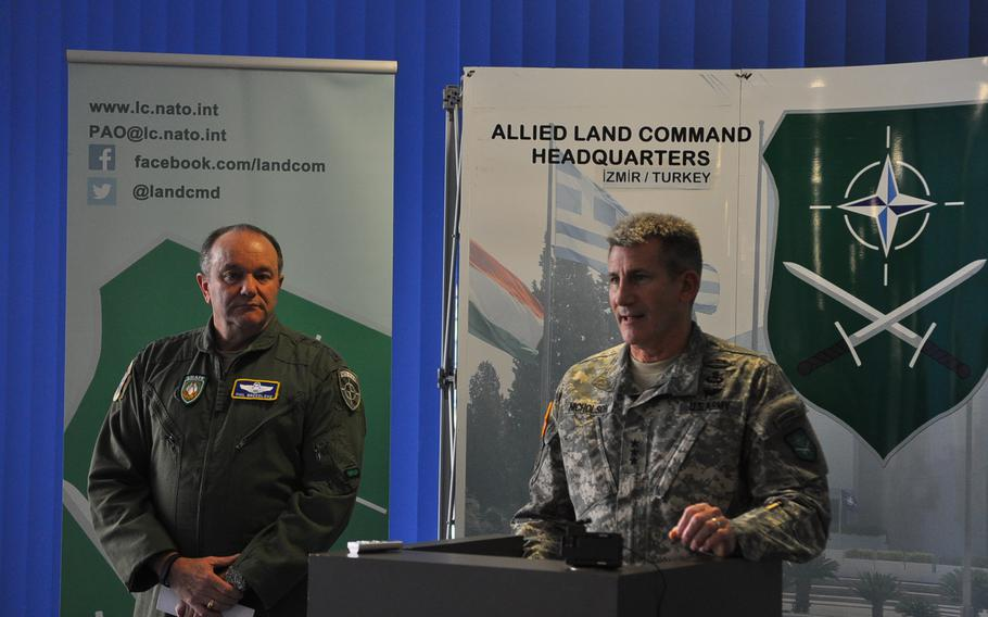 Gen. Philip Breedlove, NATO Supreme Allied Commander Europe, left, looks on while Lt. Gen. John W. Nicholson, Jr., NATO Allied Land Command commander, speaks Tuesday, March 10, 2015, at the NATO LANDCOM Corps Commanders' Conference at Ramstein Air Base, Germany. More than 140 participants from nearly all of the alliance's 28 member countries gathered to discuss the way ahead for NATO's ground forces amid a rapidly-changing security environment in Europe and elsewhere.