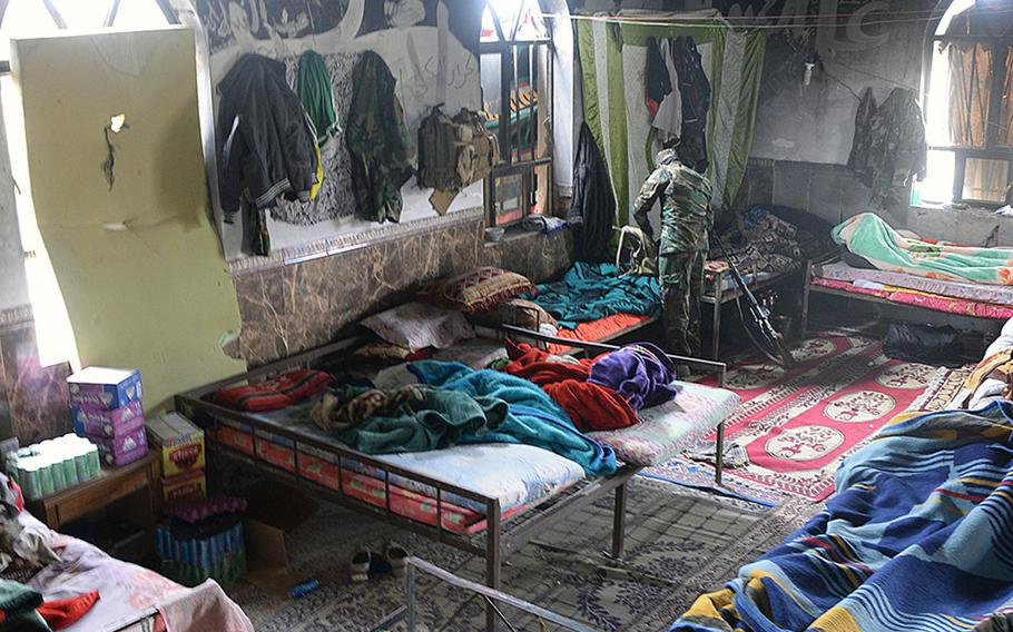 A Badr Organization Shiite militiaman tidies up in the a Jurf al-Nasr mosque, which has been turned into a kitchen and barracks, March 8, 2015. Sunni residents who have yet to be allowed back home used to worship here before the Islamic State group took over.