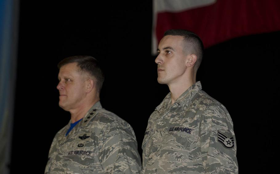 U.S. Air Force Staff Sgt. Greggory Swarz, right, stands with Gen. Frank Gorenc, commander of U.S. Air Forces in Europe-Air Forces Africa, who presented Swarz the Airman's Medal on Friday, March 13, 2015, at RAF Lakenheath, England. Swarz was awarded the medal for helping to rescue three French airmen after a crash and ensuing fire during a multinational exercise in Spain in January.