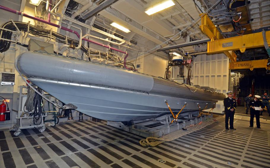 The littoral combat ship USS Fort Worth carries a rigid-hulled inflatable boat, or RHIB, as part of its surface warfare module. The ship is also meant to swap out the boat for equipment related to mine warfare and anti-submarine missions, but deployment of those modules has been delayed.