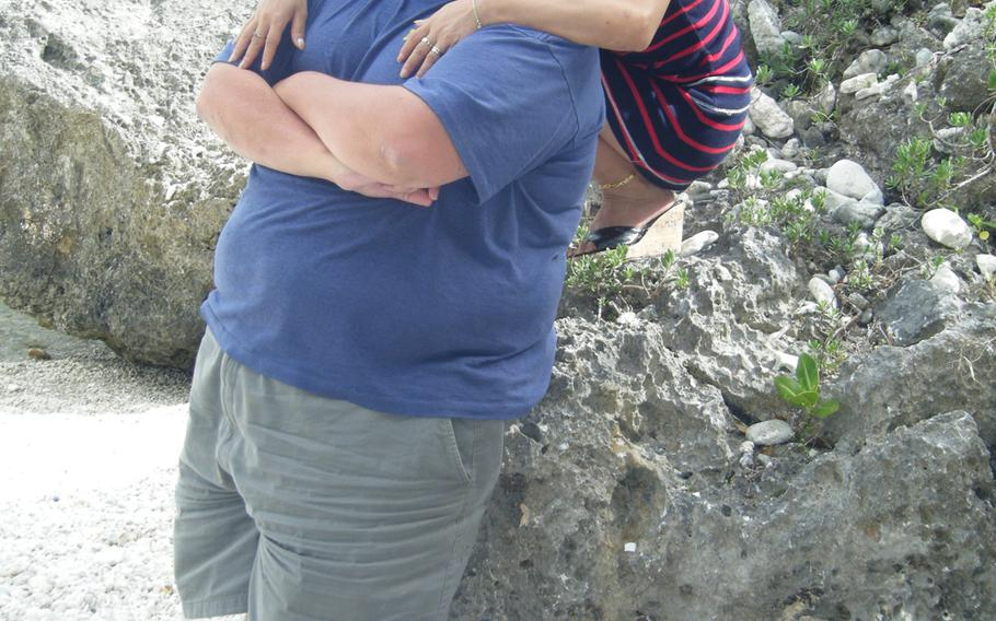 David and Li-Rong Radich at a beach on Saipan. David Radich has filed suit in U.S. federal court to allow him to possess a handgun in his home for self-defense.