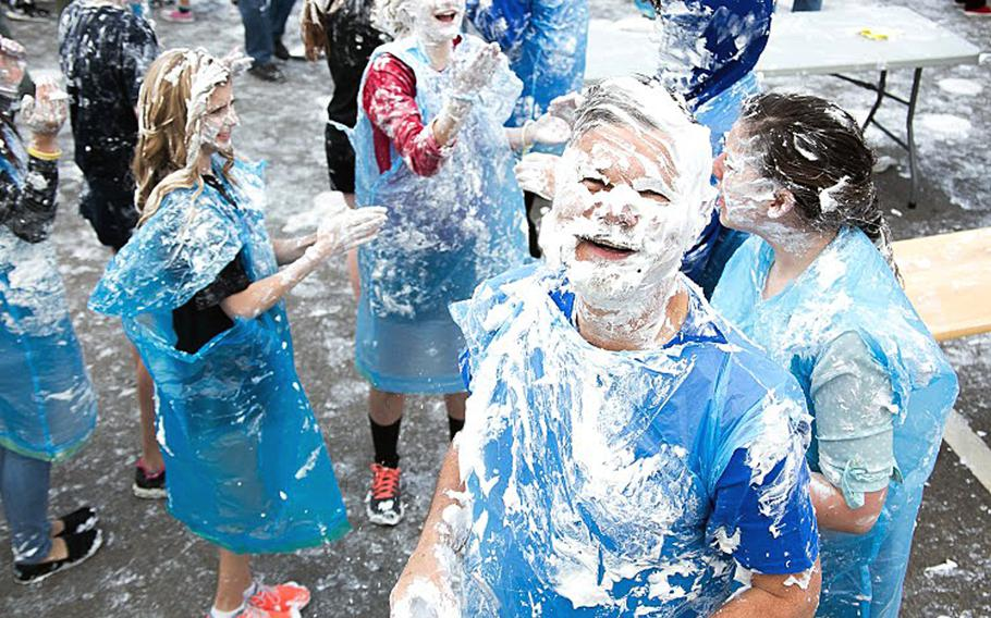 """Patch High School Principal Danny Robinson couldn't escape the shaving cream during the pie fight on March 12, 2015, at Patch Barracks, Germany. The event, sponsored by the schools math honors society, was part of an effort to commemorate """"Pi Day,"""" which celebrates the mathematical constant 3.14.   Courtesy Virginia Kozak"""