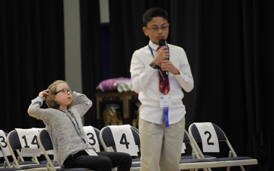 Grafenwohr Elementary School fourth-grader  Ella Scheuermann reacts after Naples sixth-grader Ryan Rayos properly spells a word Saturday, March 21, 2015, at the European PTA Spelling Bee at Ramstein Elementary School in Germany.