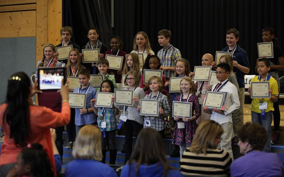 Competitors in the European PTA Spelling Bee pose for photos after the competition Saturday, March 21, 2015, at Ramstein Elementary School in Germany.