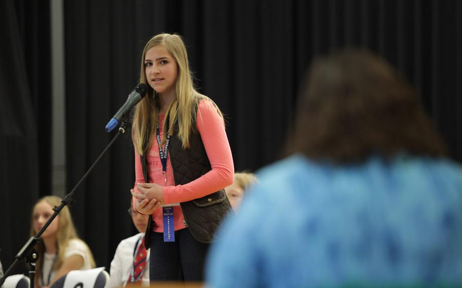 Katie Orchard, a 7th grader at Garmisch Elementary-Middle School, asks for the pronouncer to say a word again Saturday, March 21, 2015, at the European PTA Spelling Bee at Ramstein Elementary School in Germany. Orchard tied for 3rd place with Patch Elementary's Larissa Detwiler.