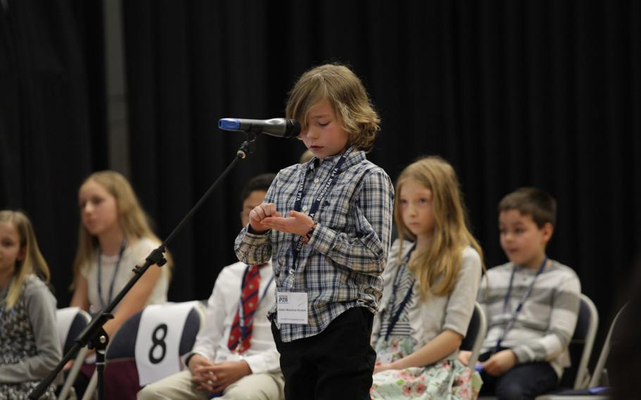 AFNORTH International School's Aidan Woodrow-Beckett spells a word out on his hand Saturday, March 21, 2015, at the European PTA Spelling Bee at Ramstein Elementary School in Germany.