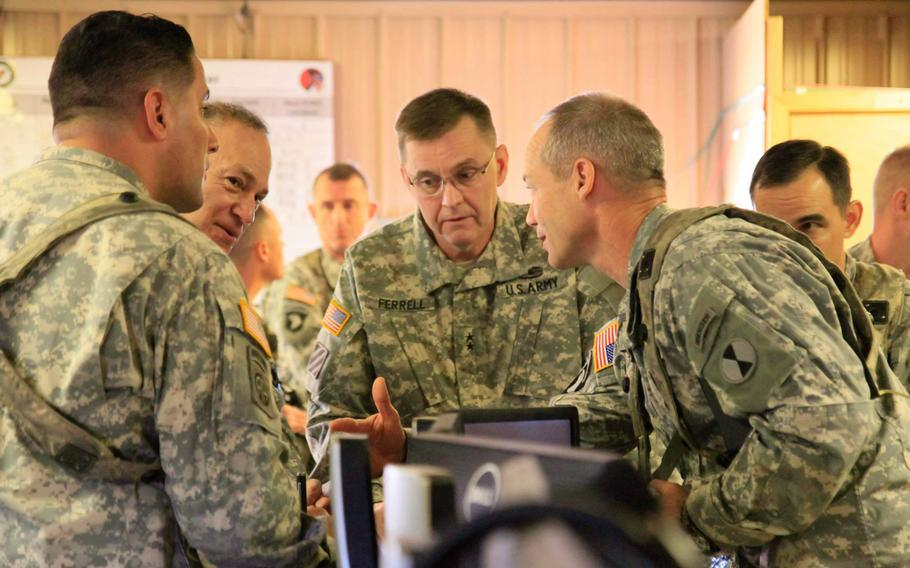 Lt. Gen. Stephen R. Lanza, I Corps commander, second from left, and Maj. Gen. Terry Ferrell, 7th Infantry Division commander, center, are  briefed by Task Force Bayonet leaders at the Joint Operations Center at Fort Polk. La., on Feb. 13, 2015, during a training exercise.  The task force, made up of about 50 soldiers from 7th Infantry Division and a dozen from 2nd Brigade Combat Team, will leave later this spring for a yearlong deployment to Kandahar Airfield, Afghanistan.