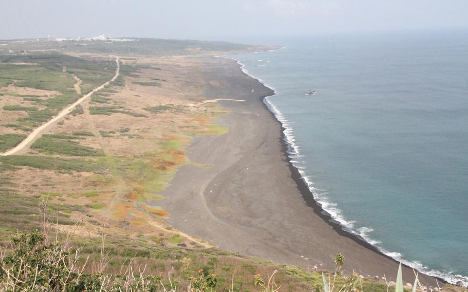 Iwo Jima's black sand beach from the top of Mount Suribachi.