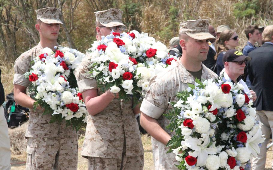 Marines lay a wreath at the ceremony commemorating the 70th anniversary of the Battle of Iwo Jima on March 21, 2015.