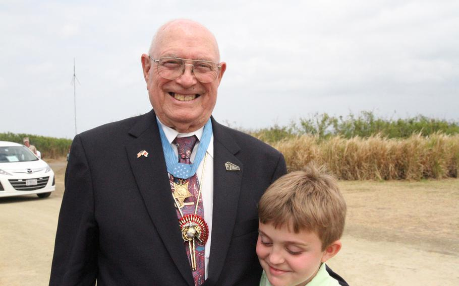 Hershel ''Woody'' Williams, left, the last living Medal of Honor recipient from the Battle of Iwo Jima attended the 70th anniversary ceremony of the battle with his great-grandson Benjamin Casey.
