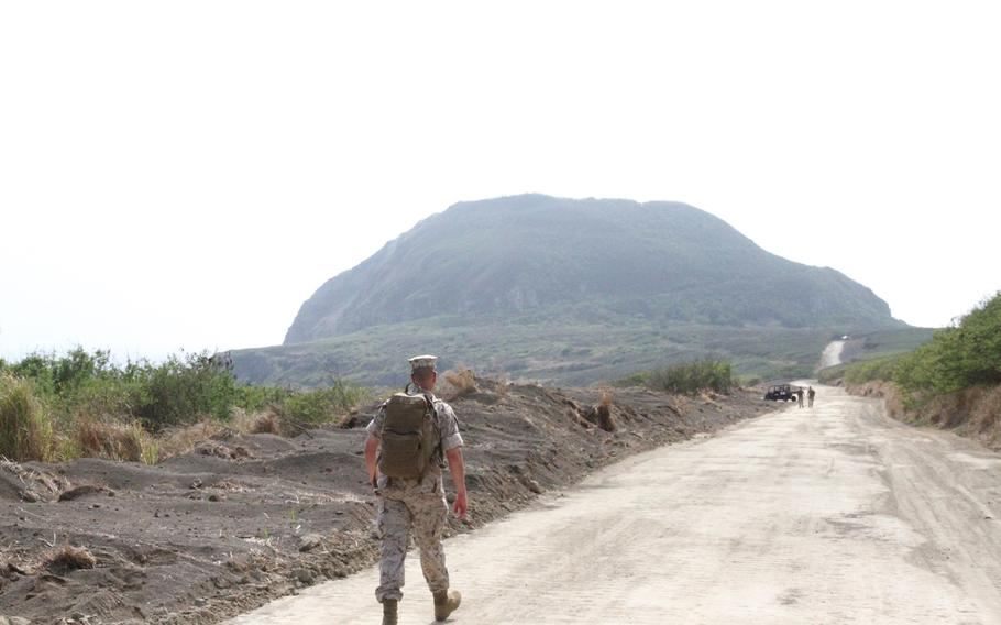 Master Gunnery Sgt. Kevin Gascon makes his way towards Iwo Jima's Mount Suribachi following the 70th anniversary ceremony. The mountain was the site of the iconic flag raising. Gascon would reach the summit a little over an hour later.