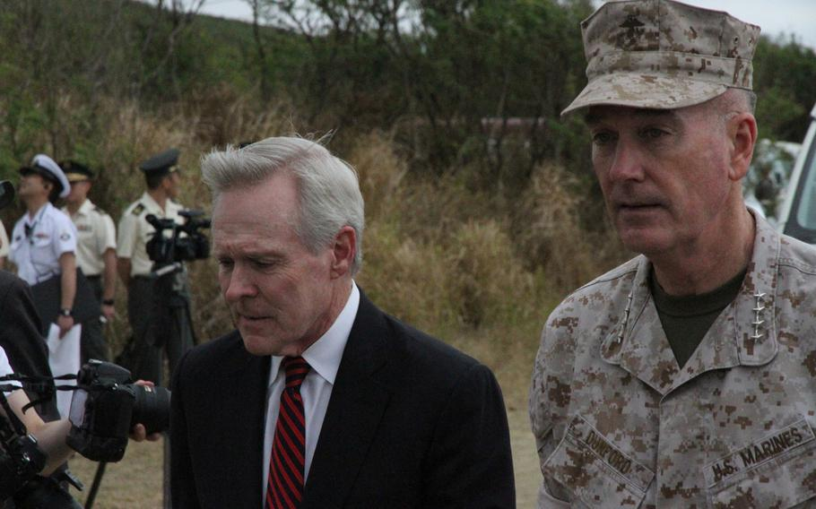 Secretary of the Navy Ray Mabus, left, and Marine Corps commandant Gen. Joseph Dunford Jr. arrive at the ceremony March 21, 2015 commemorating the 70th anniversary of the Battle of Iwo Jima.