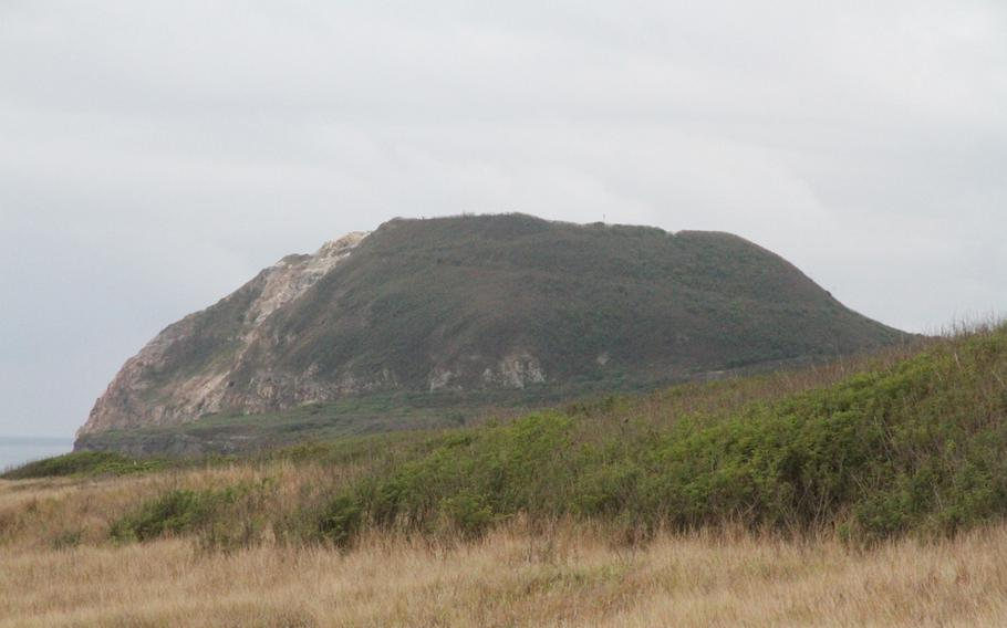 Mount Suribachi looms over the entire island of Iwo Jima, now called Iwo To by the Japanese who maintain the island as a military base. Seen here from a hill heading down to the beach.